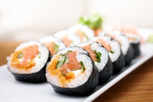 Salmon and caviar rolls served on a plate