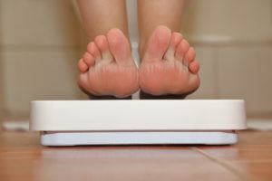 Feet on bathroom scale closeup